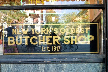 a sign above a store window