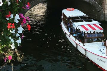 The boat under a bridge on a canal