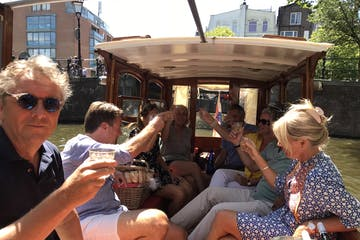 A group of people on the boat having drinks