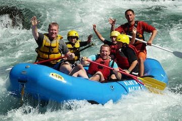 A group enjoys rafting on the Clackamas River
