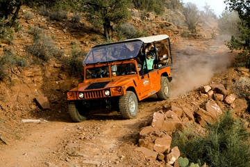 orange hummer driving rugged trail in sedona