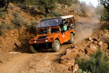 orange hummer driving rugged trail in sedona