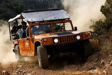 hummer driving on an off road trail