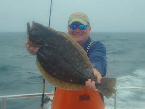 man holding a flounder