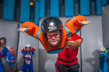 A child poses for a photo while participating in indoor skydiving in Las Vegas