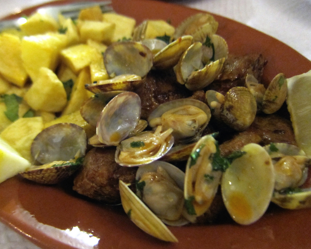 Pork and clams is a dish that embodies traditional food in Lisbon!