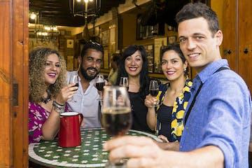 Nidia Guenard et al. holding wine glasses
