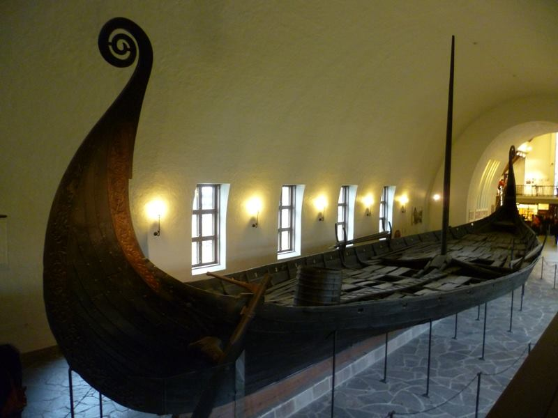 a large room with Viking Ship Museum in the background
