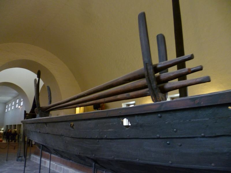 a wooden boat in a room