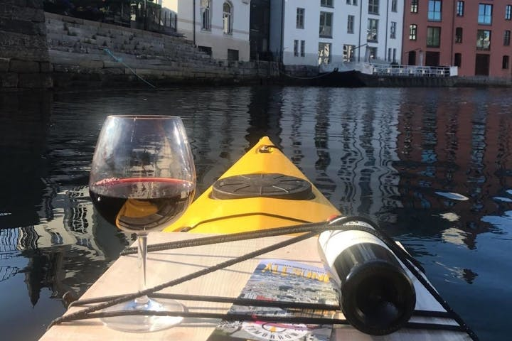 glass of red wine on a kayak