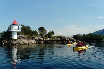 kayaking near a lighthouse
