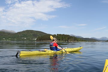 man kayaking a yellow kayak
