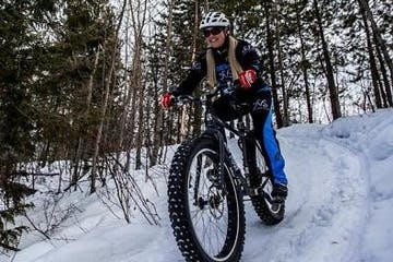 woman fat biking on snow