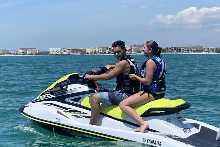 Man and woman on jet ski
