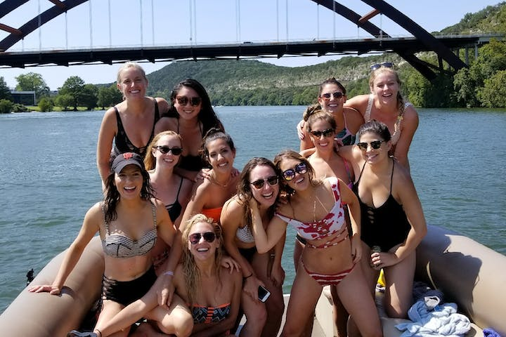 girls partying on a pontoon boat on the lake