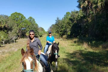 Two women enjoying a trail ride on the Deer Prairie Creek Trail