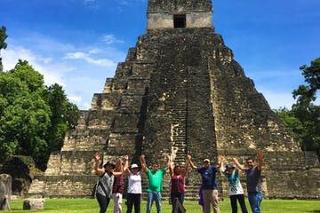 a group of people standing in front of Tikal