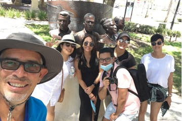 a group of people posing for the camera at Plaza de la Constitucion in St Augustine
