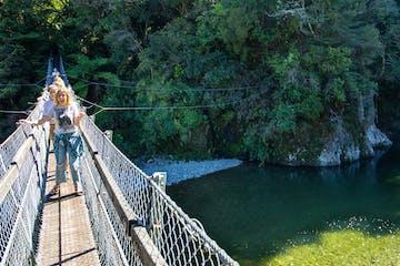 girls walking on the hanging bridge