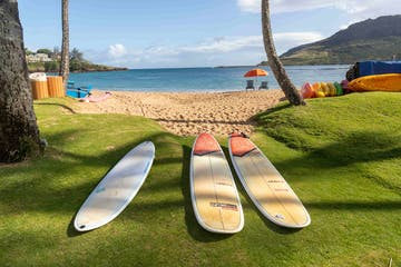a group of surf boards sitting on top of a beach
