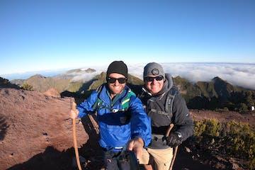 two men smile in the mountain