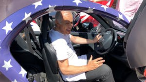 a man sitting in a car