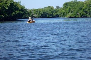 Kayaker on the large Manatee River in Bradenton, Florida