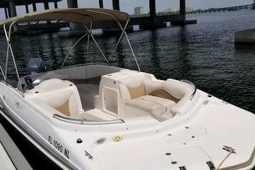 A 20 foot hurricane deck boat rental docked on the Manatee River in Manatee County Florida