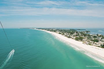Anna Maria Island in Florida View from Parasail - white sandy beaches, boat and beautiful Gulf water