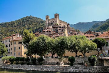 a large building with Castello del Doria in the background
