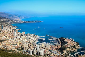 a view of a large body of water with Monaco in the background