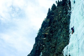 an ice climber ascending a steep ice flow in the Cascades