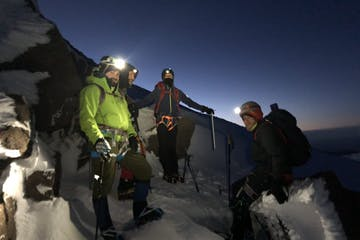 climbers on a guided climb of Mount Hood in the early morning