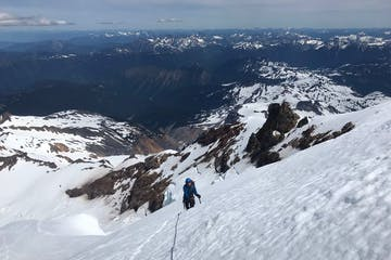 a climber on a guided mountaineering trip ascends the North Ridge of Mount Baker