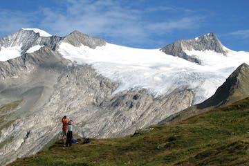 hikers on a Kaf international trip beneath a huge glacier near Grossvenediger, Austria