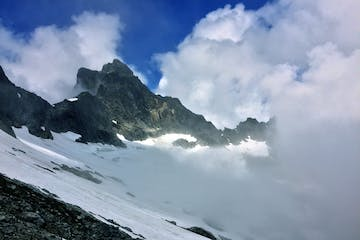 glacier and clouds enveloping Mount Triumph