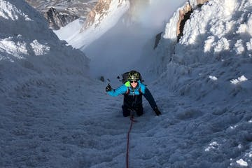 a climber on a steep snow chute on Mount Hood during a guided climb