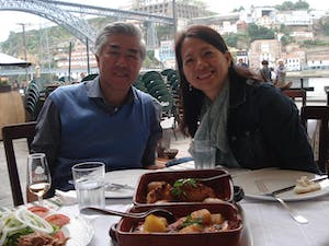 a couple eat a portuguese meal