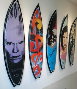 pop art surfboards hanging on the wall