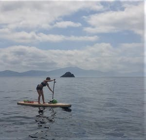 Oona tibbetts stand up paddle boarding in Tralee Bay
