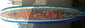 colorful graffiti on a longboard surfboard