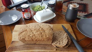 a loaf of home made bread on a wooden table
