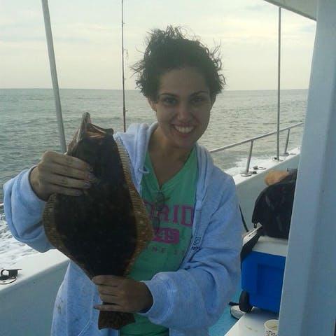 Fisher shows off her Fluke catch on Miss Belmar