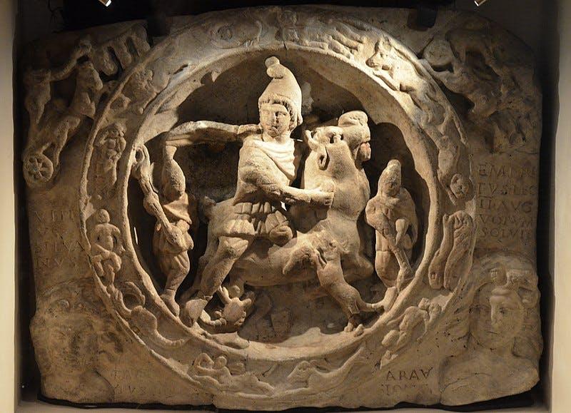 a stone statue of a person