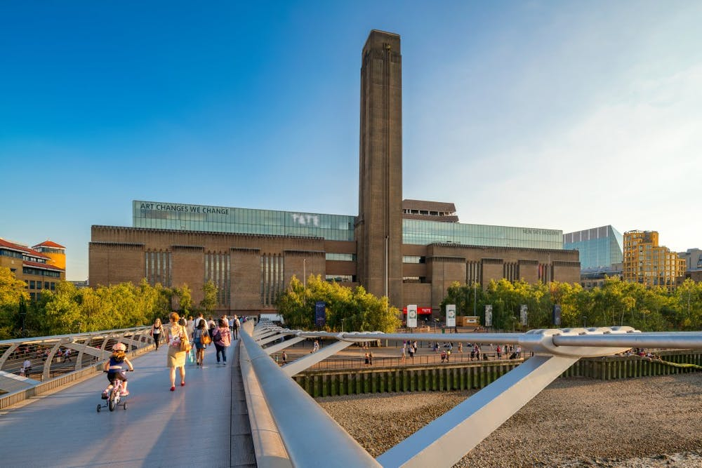 a group of people walking on Tate Modern