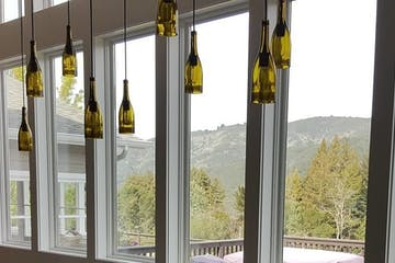 wine bottles hanging from ceiling