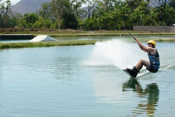 boy doing cable ski wakeboarding on the waterpark
