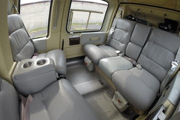 a plane sitting on the seat of a car