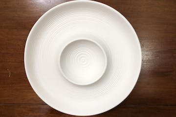 a white plate on a wooden surface