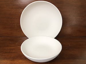 a white bowl on a table